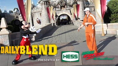 Colt McCoy Finds a New Reliable Target in Mickey Mouse