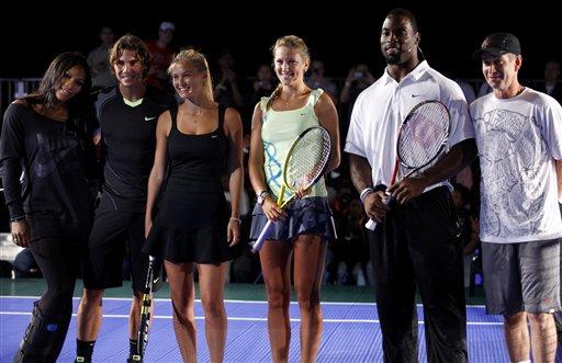 Bar Refaeli, Actor Bradley Cooper Get Their Swings in With Tennis Stars at U.S. Open