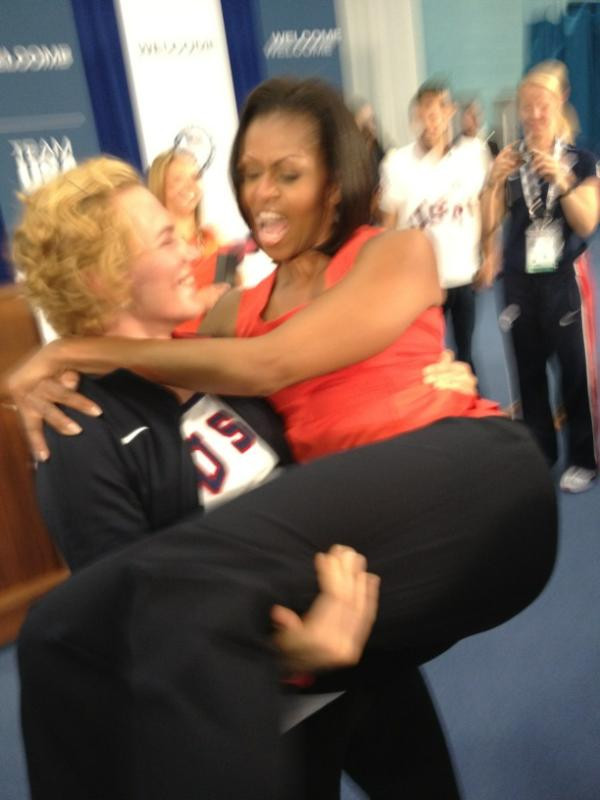Michelle Obama Gets Lift From Member of U.S. Women's Wrestling Team (Photo)