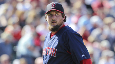 Boston Red Sox pitcher Joel Hanrahan walks back to the dugout after being relieved by manager John Farrell in the fourth inning of a Grapefruit League game against the Minnesota Twins at Hammond Stadium in Fort Myers, Fla. on Thursday, March 7, 2013. Hanrahan gave up four runs on four hits in one-third of an inning.