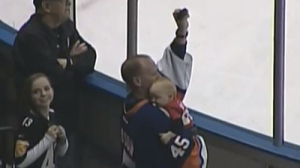 Hockey Fan Catches Puck One-Handed While Holding Baby During AHL Game (Video)