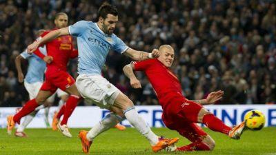 Martin Skrtel and Jesus Navas Liverpool Manchester City