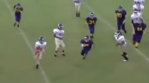 Pee Wee Football Player Lays Out Defender With Huge Stiff Arm (Video)