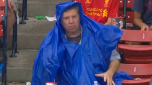 Red Sox Fan Struggles With Poncho During Boston's Win Vs. Rays (Video)