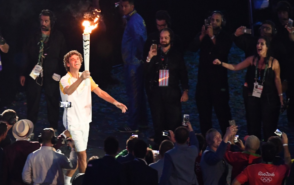 Aug 5, 2016; Rio de Janeiro, Brazil; Gustavo Kuerten carries the torch during the opening ceremonies for the Rio 2016 Summer Olympic Games at Maracana. Mandatory Credit: Kyle Terada-USA TODAY Sports