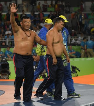 Aug 21, 2016; Rio de Janeiro, Brazil; Coaches from Mongolia protest the match of  Ikhtiyor Navruzov (UZB) and Mandakhnaran Ganzorig (MGL) by taking off their clothes after the judges ruled in favor of Navruzov in a men's freestyle 65kg wrestling bronze medal match during the Rio 2016 Summer Olympic Games at Carioca Arena 2. Mandatory Credit: Michael Madrid-USA TODAY Sports