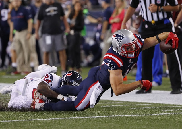 Julian Edelman stretches for a first down