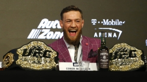 Conor McGregor Can't Get Enough Of Donald 'Cowboy' Cerrone's Python Coat