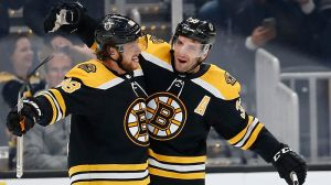 David Pastrnak Accidentally Trips Up Patrice Bergeron's Young Son On Ice