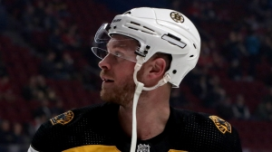 Bruins' Chris Wagner Fights Andreas Athanasiou Late In Win Vs. Red Wings