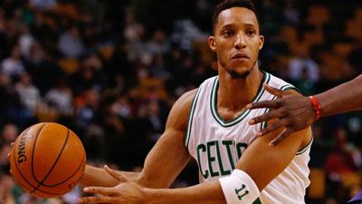 Boston Celtics guard Evan Turner passes the ball.