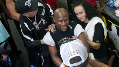 Floyd Mayweather talks to a reporter