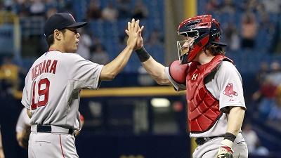 Boston Red Sox relief pitcher Koji Uehara and catcher Ryan Hanigan high five