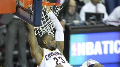 LeBron James dunks on Marcus Smart
