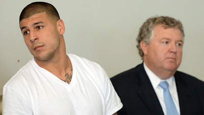 New England Patriots former tight end Aaron Hernandez (left) stands with his attorney Michael Fee as he is arraigned in Attleboro District Court.