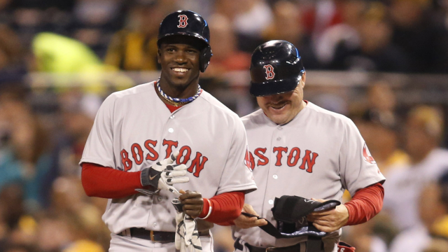 Boston Red Sox outfielder Rusney Castillo and first base coach Arnie Beyeler