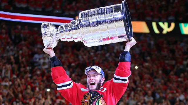 jonathan toews with the stanley cup