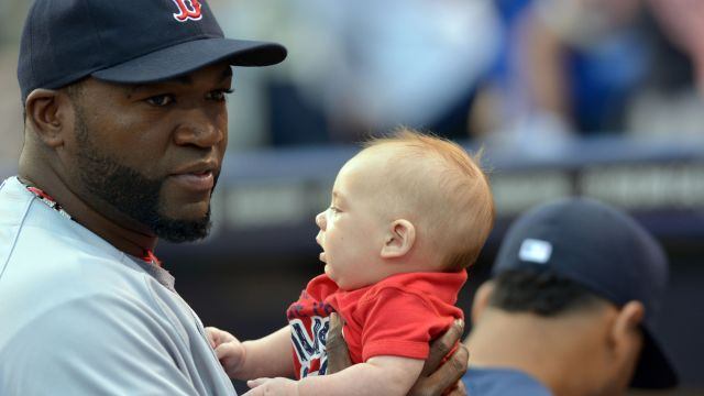 David Ortiz holds a baby