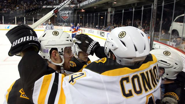 Boston Bruins players celebrating goal