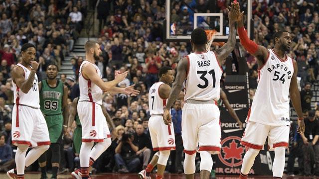 Raptors players celebrate a basket