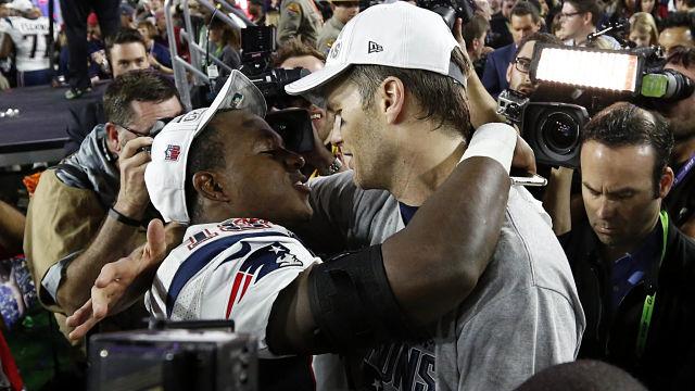 New England Patriots quarterback Tom Brady (12) celebrates with wide receiver Matthew Slater