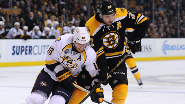 Nashville Predators left wing James Neal (18) battles with Boston Bruins center Patrice Bergeron
