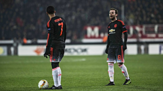 Manchester United's Memphis Depay and Juan Mata
