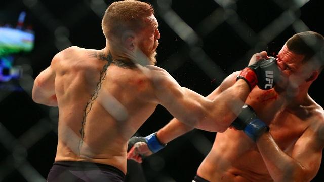 Conor McGregor punches Nate Diaz