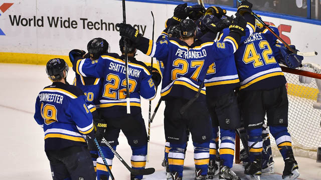 St. Louis Blues teammates celebrate after defeating the Chicago Blackhawks 3-2