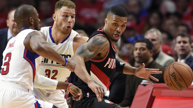 Portland Trail Blazers guard Damian Lillard (0) controls the ball against Los Angeles Clippers forward Blake Griffin (32) and guard Chris Paul