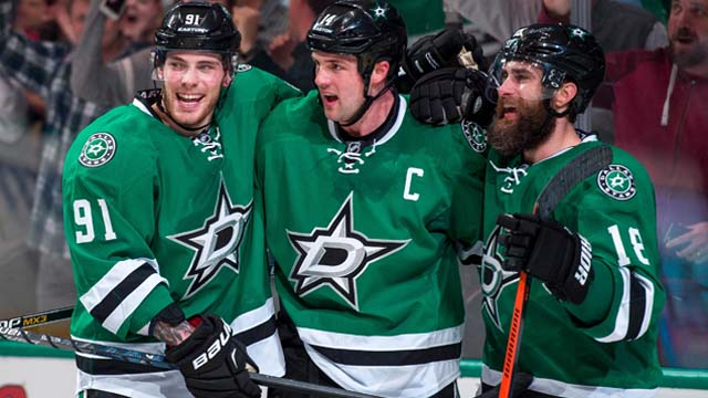 Dallas Stars left wing Jamie Benn (14) and right wing Patrick Eaves (18) and center Tyler Seguin