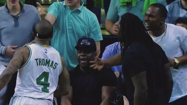 Isaiah Thomas celebrates with Patriots players