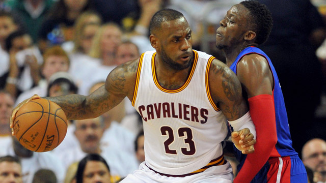 Cleveland Cavaliers forward LeBron James works against Detroit Pistons guard Reggie Jackson