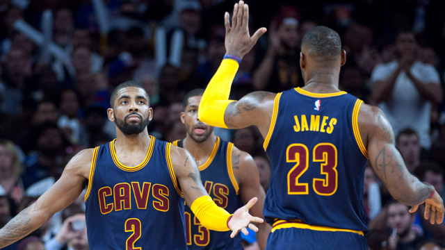 Cleveland Cavaliers guard Kyrie Irving (2) high fives forward LeBron James