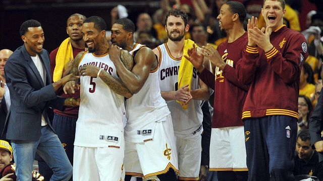 Cavaliers players celebrate on the bench
