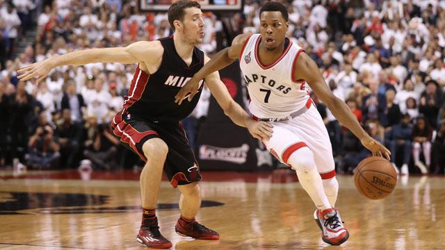 Toronto Raptors point guard Kyle Lowry (7) drives to the basket past Miami Heat point guard Goran Dragic