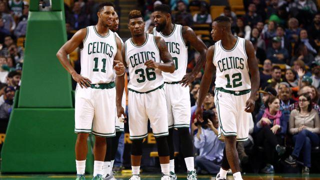 Celtics teammates huddle on the court