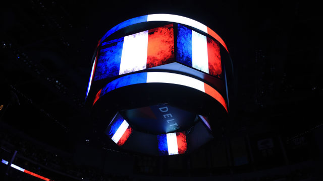 The flag of France is displayed in honor of the victims of the Paris terrorist attacks before the game between the Los Angeles Lakers and the Detroit Pistons