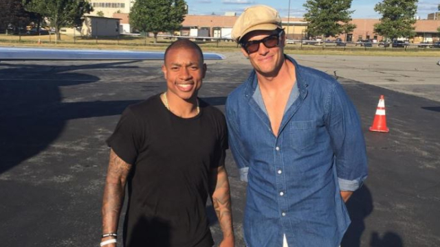 Boston Celtics point guard Isaiah Thomas and New England Patriots quarterback Tom Brady