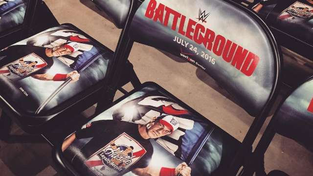 WWE Battleground logo on chairs