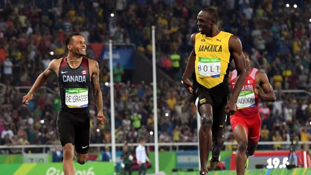 Olympic sprinters Andre De Grasse and Usain Bolt