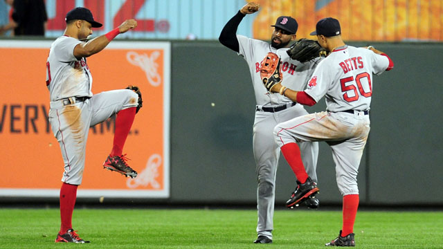 Boston Red Sox outfielders Chris Young (30), Jackie Bradley, Jr. (25) and Mookie Betts
