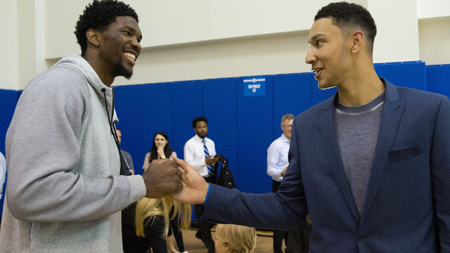 Philadelphia 76ers number one overall draft pick Ben Simmons (R) is greeted by center Joel Embiid