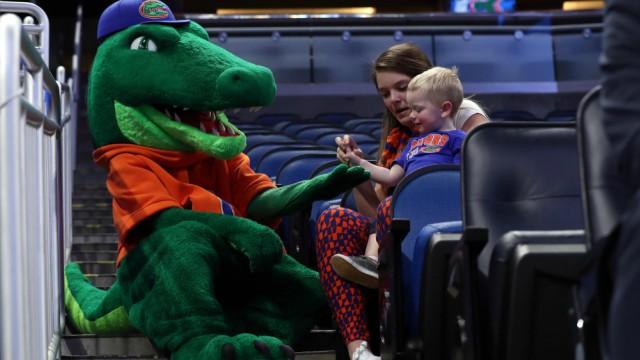 Florida Gators mascot and young fan