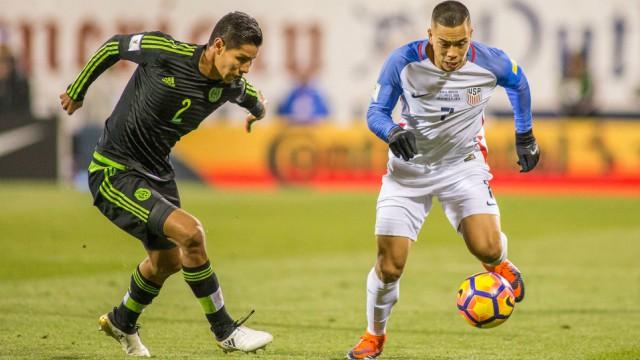 USA forward Bobby Wood and Mexico defender Hugo Ayala