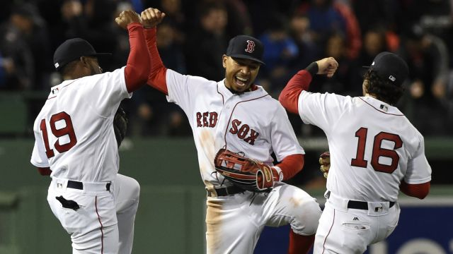 Jackie Bradley Jr., Mookie Betts and Andrew Benintendi celebrate after a win