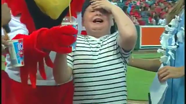 Kid gets brain freeze at baseball game during Icee chugging contest