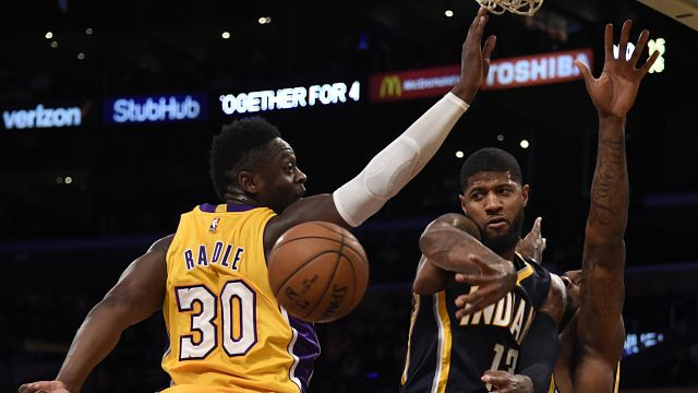 Indiana Pacers forward Paul George and Los Angeles Lakers forward Julius Randle