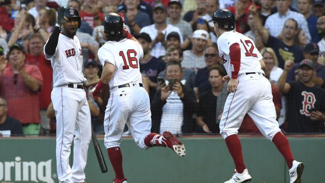 Boston Red Sox outfielder Andrew Benintendi and infielders Brock Holt and Eduardo Nunez