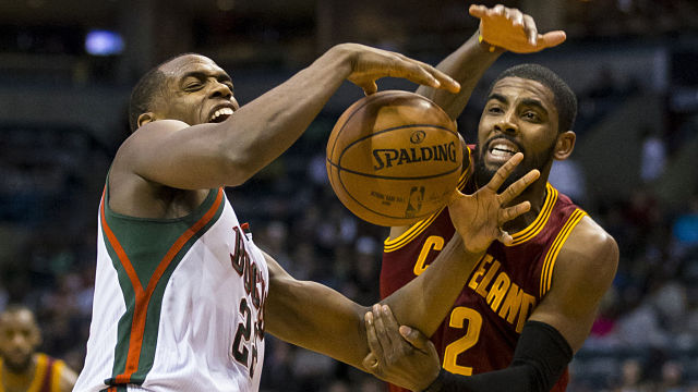 Milwaukee Bucks forward Khris MIddleton and Boston Celtics guard Kyrie Irving